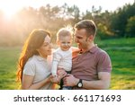 happy young family walking... | Shutterstock . vector #661171693