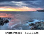 Atlantic coastline sunrise. - stock photo