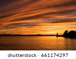 Stock photo red sunset with lighthouse victoria park prince edward island 661174297