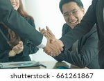 Small photo of Businessmen agree to cooperate