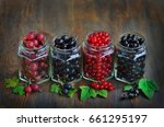 berries in cans for canning ... | Shutterstock . vector #661295197
