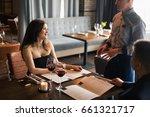 close up of waiter hand noting... | Shutterstock . vector #661321717