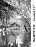 Small photo of Black and white image of the gazebo, shade and reflection on the water in the park, Which shaded from the big trees.
