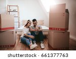 young couple moving in new home ... | Shutterstock . vector #661377763
