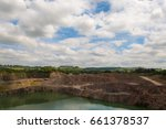 Small photo of Quarrying operations at Wick Quarry. Machinery engaged in limestone aggregate mining and crushing near Bristol, with English countryside and bright sky