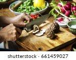 hands using a knife chopping... | Shutterstock . vector #661459027