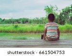 little boy unhappy sitting... | Shutterstock . vector #661504753