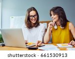 two young women working... | Shutterstock . vector #661530913