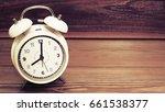 closeup white clock in 8 o...   Shutterstock . vector #661538377