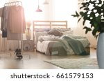 white bedroom with wooden bed ... | Shutterstock . vector #661579153