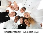 Small photo of Low Angle View Of Happy Restaurant Staff Standing Against White Background
