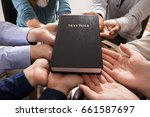 holy bible over the hands of... | Shutterstock . vector #661587697