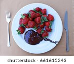 strawberry with chocolate on a... | Shutterstock . vector #661615243
