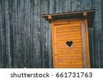 wooden toilet in countryside | Shutterstock . vector #661731763