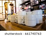 group plates and coffee mugs in ... | Shutterstock . vector #661740763