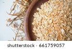 oatmeal  rolled oats in wooden... | Shutterstock . vector #661759057