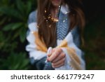 close up of girl holding...   Shutterstock . vector #661779247