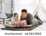 clever young dad sharing his... | Shutterstock . vector #661824883