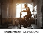 young man using exercise bike... | Shutterstock . vector #661933093