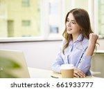 young caucasian businesswoman... | Shutterstock . vector #661933777