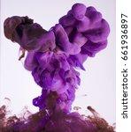 colors ink drops in water | Shutterstock . vector #661936897