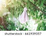 chasing rain doll hanging on...   Shutterstock . vector #661939357