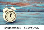closeup white clock in 12 o... | Shutterstock . vector #661950937