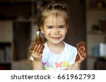 pretty smiling girl showing her ... | Shutterstock . vector #661962793