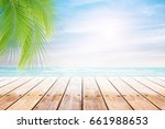 empty wooden table and palm... | Shutterstock . vector #661988653