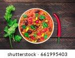 an overhead photo of chili con... | Shutterstock . vector #661995403