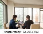 two men discussing company... | Shutterstock . vector #662011453