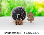 Small photo of Miniature people : Work against time for increase money using as business background