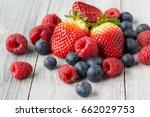 assorted fresh juicy berries on ... | Shutterstock . vector #662029753