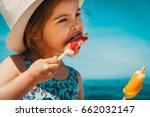 little and cute girl eating ice ... | Shutterstock . vector #662032147