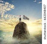 businessman reachs the goal.... | Shutterstock . vector #662048407