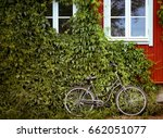 bicycle with green foliage wall ... | Shutterstock . vector #662051077