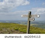 a woodedn signpost on the... | Shutterstock . vector #662054113