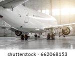 airplane in hangar  rear view... | Shutterstock . vector #662068153