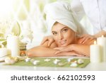 girl lying down on a massage bed | Shutterstock . vector #662102593