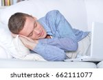 young man sleeping in front of... | Shutterstock . vector #662111077