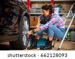 beautiful woman car mechanic in ... | Shutterstock . vector #662128093