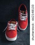 pair of red sneakers on dark... | Shutterstock . vector #662148133