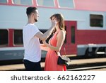 Small photo of Distance brings sadness when saying goodbye to your loved ones, caucasian young couple saying goodbye at train station during sunny summer day