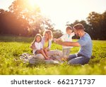 family with children on picnic... | Shutterstock . vector #662171737