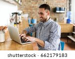 happy man working on laptop. in ... | Shutterstock . vector #662179183