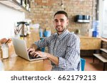 happy man working on laptop. in ... | Shutterstock . vector #662179213