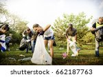 diverse group of people picking ... | Shutterstock . vector #662187763
