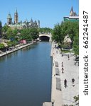 Small photo of OTTAWA - JUNE 2017: Ottawa is noted for its abundant cycling trail, such as this one alongside the Rideau Canal, running toward the Parliament Buildings.