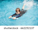 boy playing in outdoor swimming ... | Shutterstock . vector #662252137