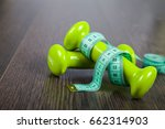 dumbbells and measuring tape ... | Shutterstock . vector #662314903